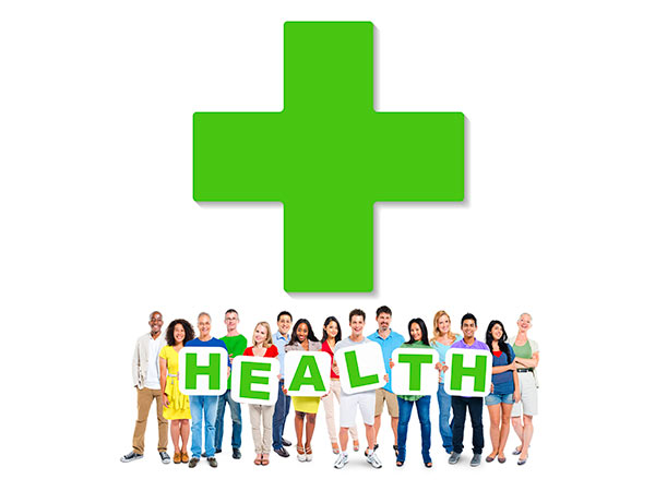 Green health cross with people holding cards to spell the word health underneath.