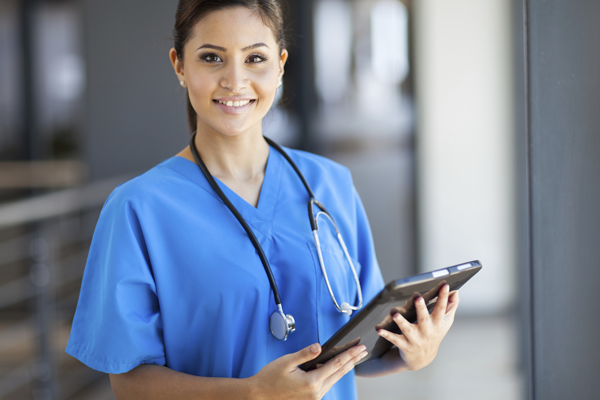 Nurse holding tablet.